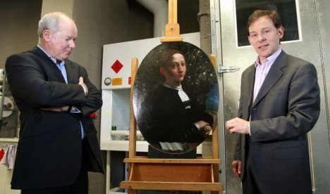 National Gallery of Victoria paintings conservator Karl Villis (right) and director Gerard Vaughan stand beside the painting